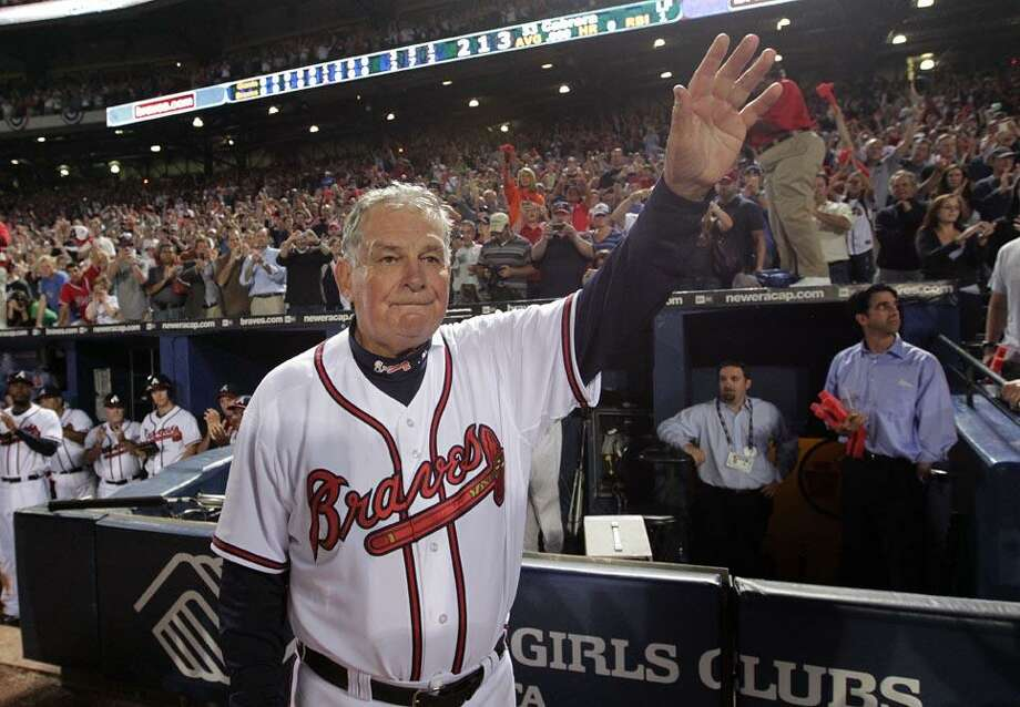 Atlanta Braves manager Bobby Cox waves to fans after a 3-2 loss to the San Francisco Giants in Game 4 of baseball's National League Division Series on Monday in Atlanta. After a half-century in baseball, most of it in uniform, Cox must move out of the dugout.  (AP Photo/Dave Martin) Photo: AP / AP
