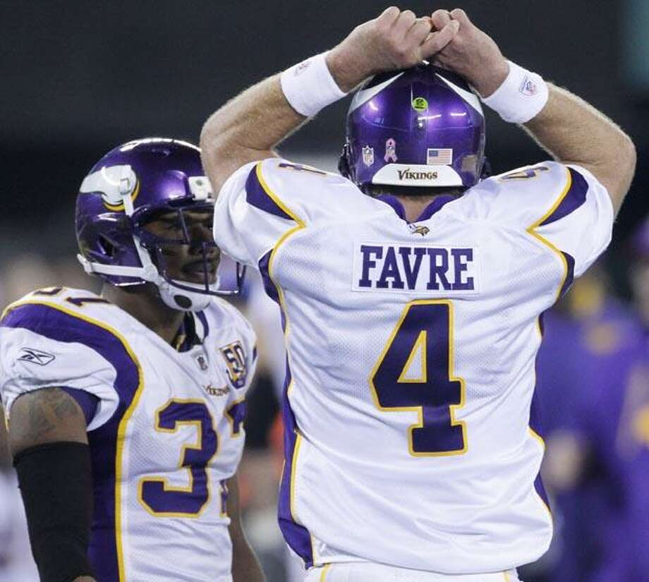 Minnesota Vikings' Brett Favre reacts after failing to get a first down during the fourth quarter of an NFL football game against the New York Jets early Tuesday  in East Rutherford, N.J. The Jets won 29-20. (AP Photo/Seth Wenig) Photo: AP / AP