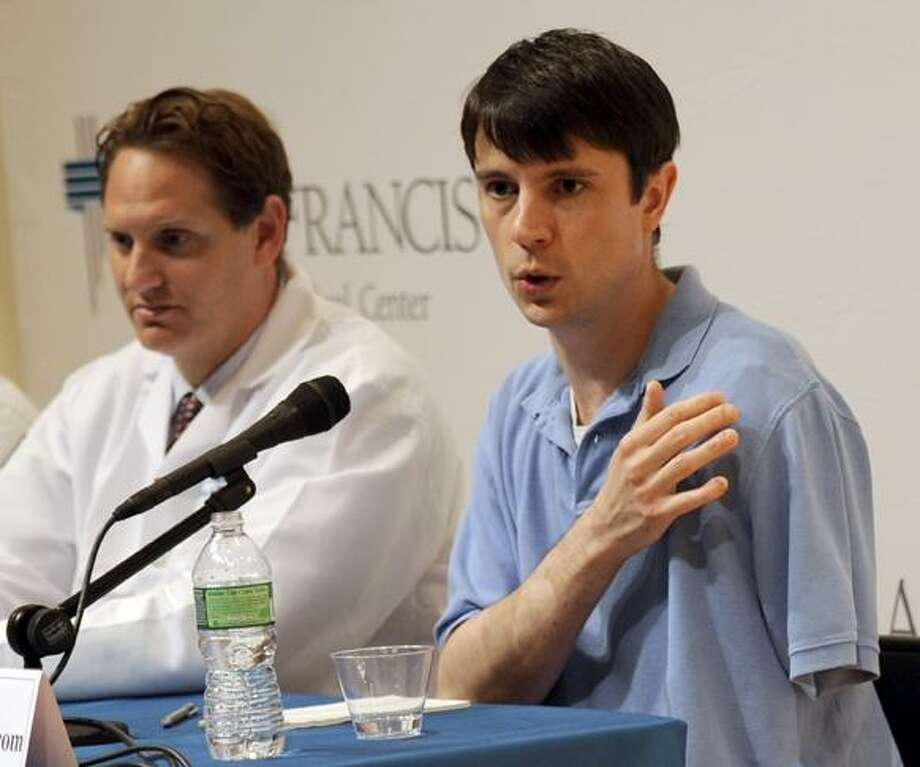 "Jonathan Metz speaks at a news conference at St. Francis Hospital in Hartford Tuesday. Metz had his arm stuck in his furnace boiler for about 12 hours when he asked himself ""what would MacGyver do?"" and concluded that amputating the limb was his only chance for survival. The 31-year-old West Hartford man, who was released from the hospital Monday, met with members of the media Tuesday for the first time since getting his arm stuck in his furnace for two days and nearly cutting off the limb. He said he spent six hours psyching himself up for the self-amputation. His fantasy, he said, was that he could cut off the arm, run upstairs and put it in his freezer, call 911, then go to the hospital and get it reattached. At left is Dr. Scott Ellner. (AP) Photo: AP / FR170410 AP"