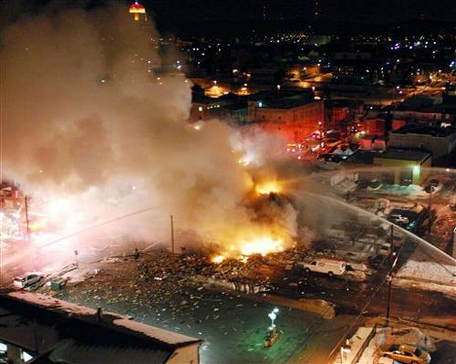 Emergency crews respond to a massive explosion in a residential neighborhood of downtown Allentown, Pa. The natural gas explosion in Allentown killed at least one person, leveled two houses, spawned fires that burned for more than seven hours and prompted the evacuation of hundreds of people. At least five others were unaccounted for Thursday. (AP Photo/Express-Times, Chris Post) NO SALES Photo: AP / Easton Express Times