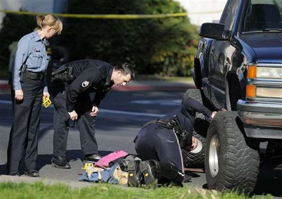 Police inspect the scene where a pickup truck, seen at right, plowed into a group of junior high school students, killing one girl and injuring four others, as they walked to Mae Hensley Junior High school in Ceres, Calif., Wednesday morning. (AP Photo/The Modesto Bee, Brian Ramsay) MAGS OUT; TV OUT Photo: AP / The Modesto Bee