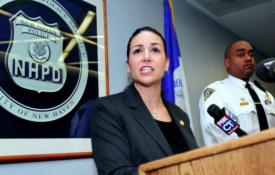 Lt. Julie Johnson (center) of the New Haven Police Department's Special Investigations Unit answers question during a press conference at the NHPD in New Haven concerning a serial rapist at large who has committed his crimes in the Newhallville area of New Haven on 2/10/2011. At right is Lt. Thaddeus Reddish. Photo by Arnold Gold/New Haven Register AG0402E