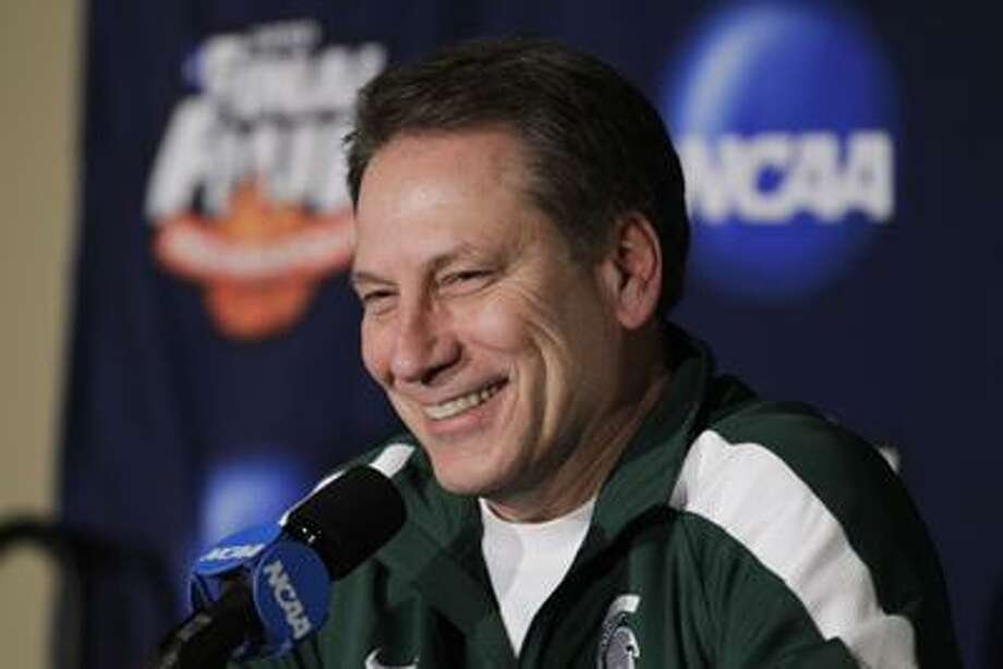 This April 1 file photo shows Michigan State Spartans' head coach Tom Izzo during an interview session for the NCAA Final Four college basketball tournament, in Indianapolis. Michigan State athletic director Mark Hollis told The Associated Press on Monday, June 7, the Cleveland Cavaliers were interested in Izzo. On Tuesday, June 15, Izzo rejected the opportunity to coach the Cavs. (AP) Photo: ASSOCIATED PRESS / AP2010