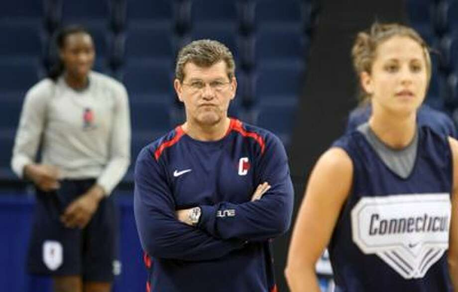 Connecticut  coach Geno Auriemma, center, watches his team during NCAA college basketball practice, Saturday. (Associated Press) Photo: ASSOCIATED PRESS / AP2010