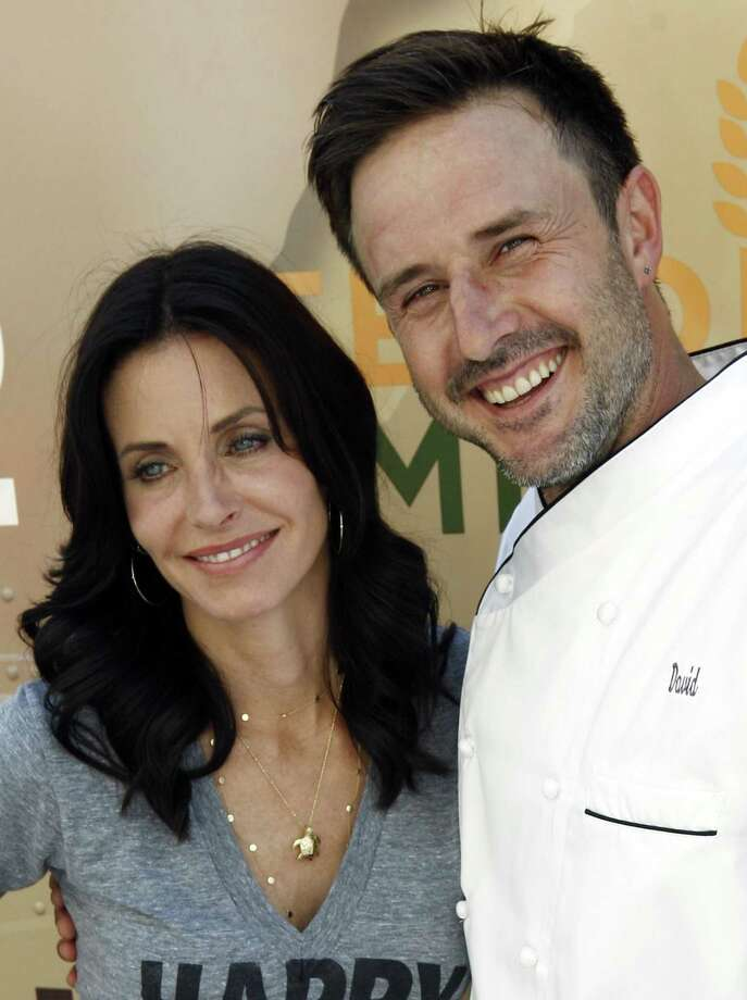 FILE - In this Aug. 31, 2009 file photo, David Arquette, right, and Courteney Cox Arquette pose together at the launch of The Cheesecake Factory's Drive Out Hunger Tour benefiting Feeding America in Culver City, Calif.  (AP Photo/Matt Sayles, file) Photo: ASSOCIATED PRESS / AP