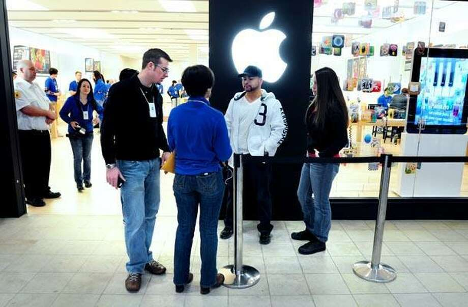 A customer waits to enter the Apple store in the West Farms Mall in Farmington shortly after the store opened at 7:00 a.m. on 2/10/2011. (Photo by Arnold Gold)