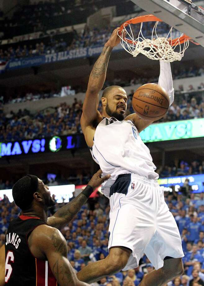 Dallas Mavericks' Tyson Chandler, right, dunks over Miami Heat's LeBron James during the first quarter of Game 5 of their NBA basketball finals in Dallas, Thursday,  June 9, 2011. Mavericks won 112-103, taking a 3-2 lead in the finals best-of-seven series. (AP Photo/El Nuevo Herald, Hector Gabino) Photo: ASSOCIATED PRESS / AP2011