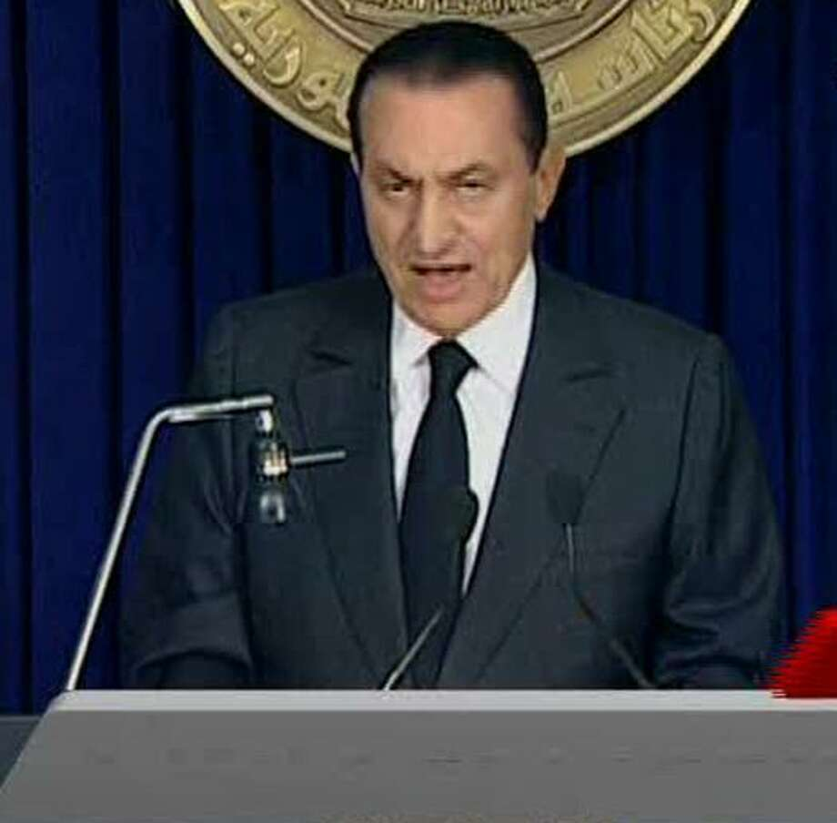 Egyptian President Hosni Mubarak begins to make a televised statement to his nation in this image taken from TV aired Thursday Feb. 10, 2011. Following more than two weeks of protests, anti-government demonstrators have been given hope by official statements suggesting that President Mubarak may step down after 30 years in power.  (AP Photo/ Egypt TV via APTN)  EGYPT OUT TV OUT Photo: ASSOCIATED PRESS / AP2011