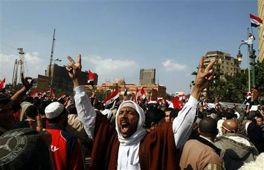 An nti-government protester chant slogans during the continuing demonstration in Tahrir Square, in downtown Cairo, Egypt,  Friday, Feb. 11, 2011. (AP Photo/Khalil Hamra) Photo: AP / AP