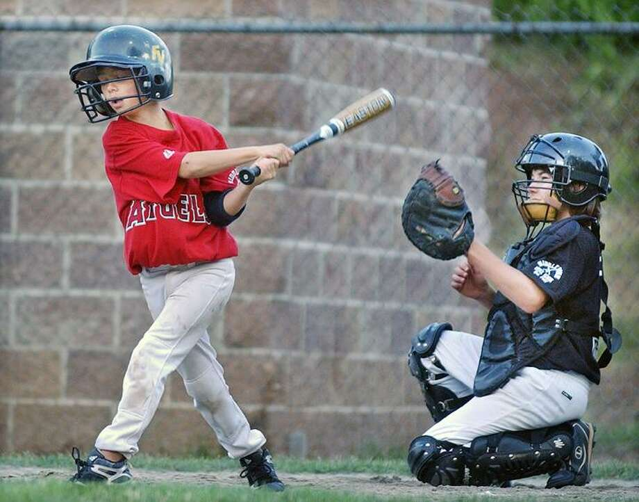 Elks catcher Cameron Cietek keeps an eye on the ball as  Frank & Gloria's Angels Sean Black is at bat. The Elks defeated the Angels 13-11. (Catherine Avalone / Middletown Press)