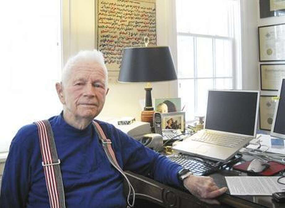 "Egypt authority and Saratoga Springs resident Alexander ""Sam"" Aldrich, shown Thursday at his home office, offers his perspective on the events in Egypt in a Q&A. (LUCIAN McCarty, The Saratogian)"