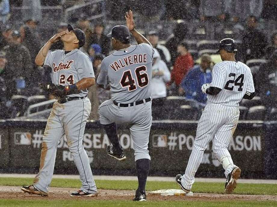 Detroit Tigers first baseman Miguel Cabrera (24) and relief pitcher Jose Valverde (46) celebrate after New York Yankees' Robinson Cano (24) grounded out in the ninth inning of Game 2 of baseball's American League division series to give the Tigers a 5-3 win on Sunday, Oct. 2, 2011, at Yankee Stadium in New York. (AP Photo/Kathy Kmonicek) Photo: ASSOCIATED PRESS / AP2011