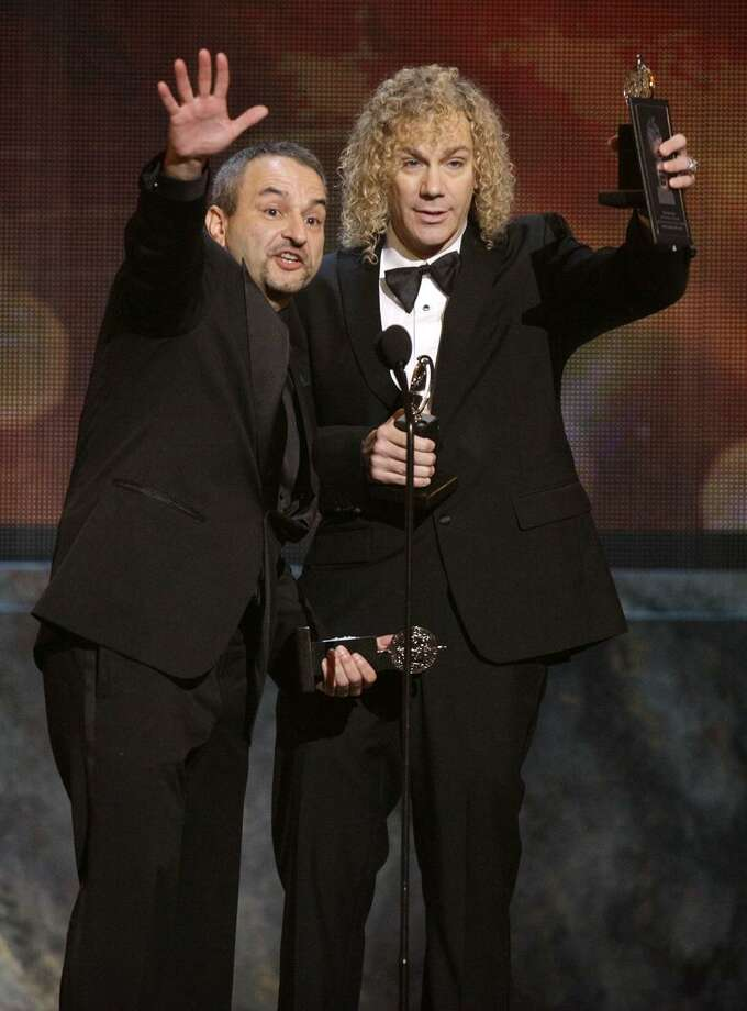 "Joe DiPietro, left, and David Bryan accept the Tony Award for Best Original Score (Music and/or Lyrics) Written for the Theatre for their work in ""Memphis"" during the 61st Tony Awards, Sunday in New York. (AP) Photo: AP / AP"