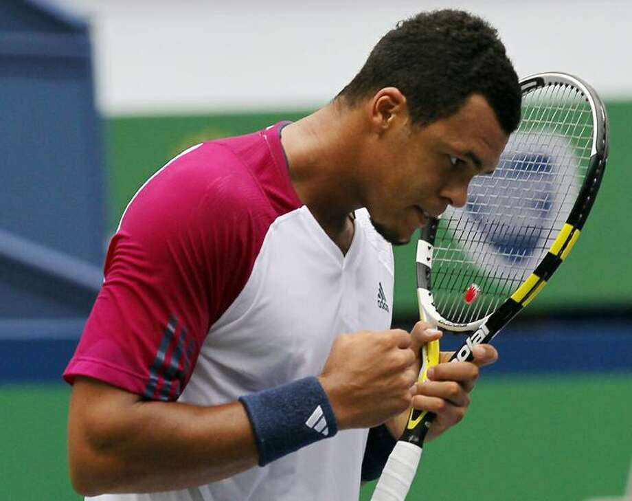 France's Jo-Wilfried Tsonga celebrates after defeating Feliciano Lopez of Spain during the round one of the Shanghai Masters tennis tournament in Shanghai Monday. Tsonga won 7-6, 6-3. (AP Photo/Eugene Hoshiko) Photo: AP / AP