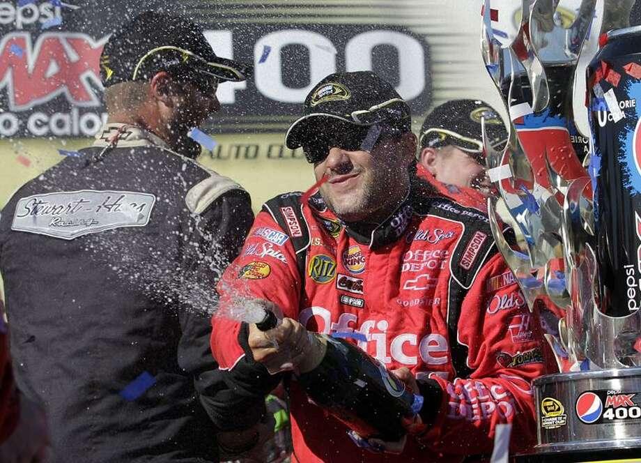 Tony Stewart celebrates after winning the NASCAR Sprint Cup Series auto race at Auto Club Speedway in Fontana, Calif., Sunday. (AP Photo/Jae C. Hong) Photo: AP / AP