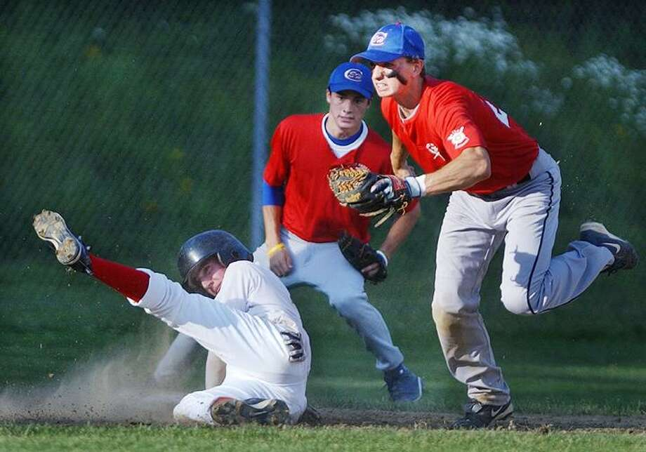 Post 103 Westbrook's Matthew Kaufman slides into third as East Haddam Post 156 Evan Cemer waits for the call. (Catherine Avalone / The Middletown Press)