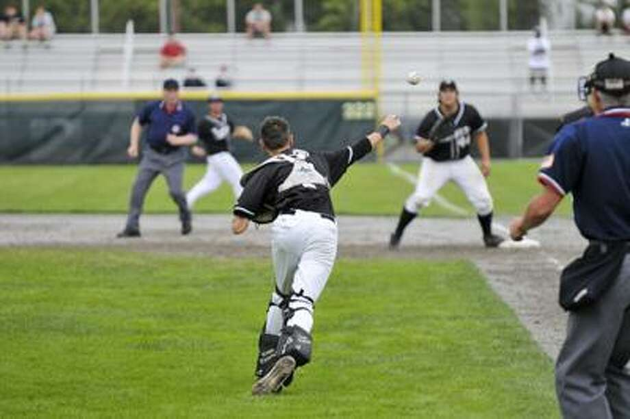 Xavier catcher Lou Iannotti (7) throws to first baseman, Hayden Stanton (44) to make the out. (Ralph Chappell / Special to the Press) / Ralph Chappell 2010