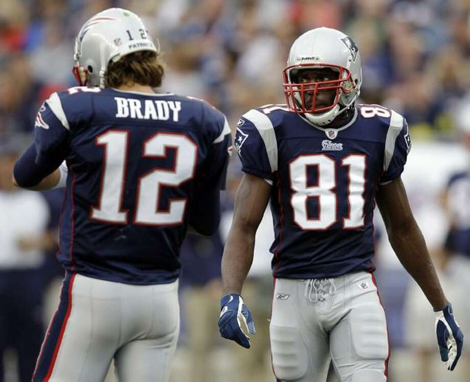 In this Sept. 26, 2010, file photo, New England Patriots wide receiver Randy Moss (81) and  quarterback Tom Brady (12) look on during an NFL football game against the Buffalo Bills in Foxborough, Mass. The Patriots traded the seven-time Pro Bowl receiver on Wednesday, Oct. 6, 2010, giving Moss the exit he expected all along and sending him back to the place where he became a superstar.  (AP Photo/Stephan Savoia, File) Photo: AP / AP