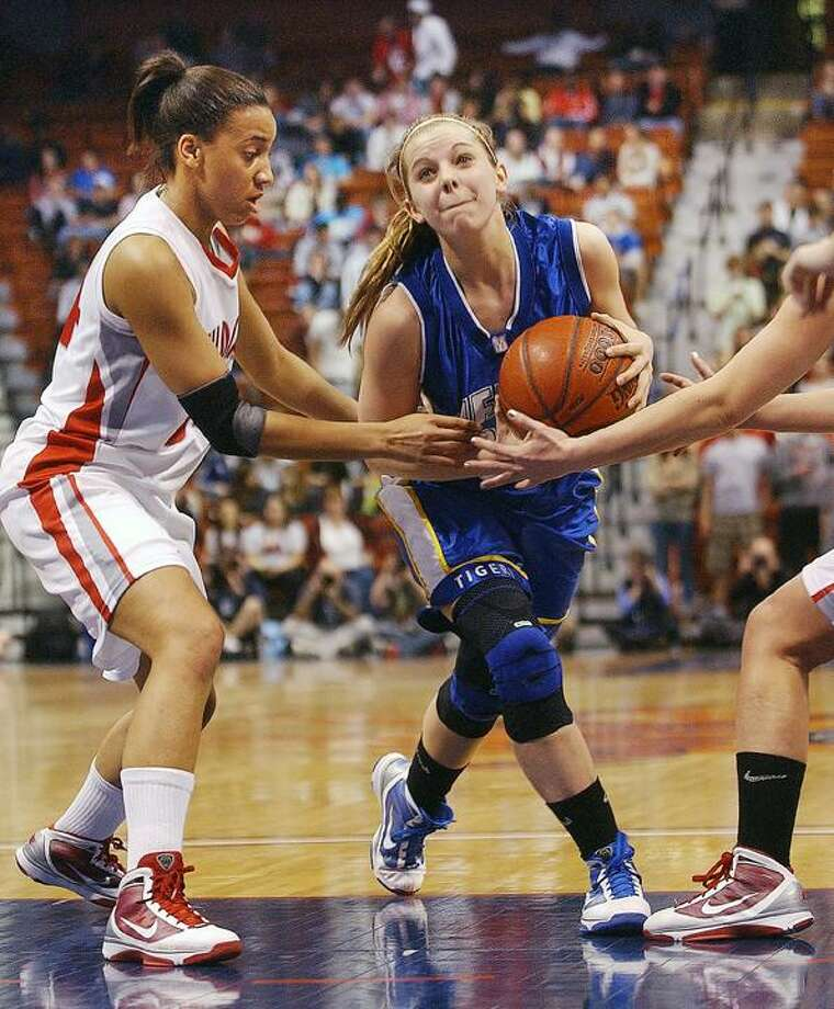 Mercy's Amber Bepko drives the lane against Norwich Free Academy in the Class LL state championship at Mohegan Sun. (Catherine Avalone / Middletown Press)