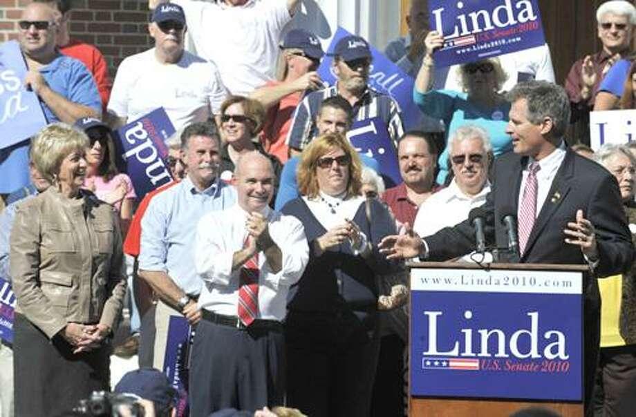 U.S. Sen. Scott Brown, R-Mass., right, gestures toward Republican candidate for U.S. Senate Linda McMahon, far left, at a rally in Milford, Conn., Saturday, Oct. 9, 2010. (AP Photo/Jessica Hill) Photo: AP / AP2010