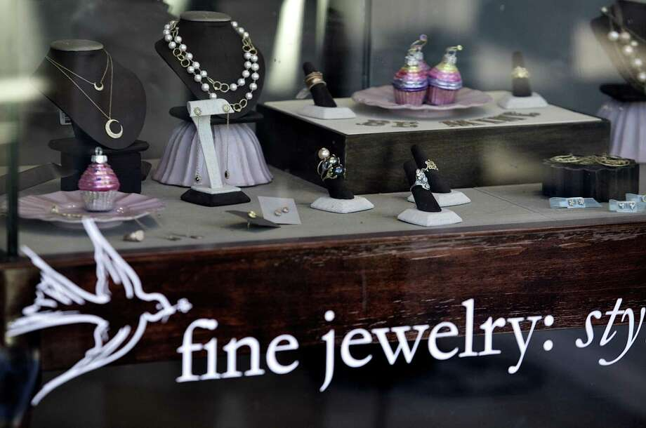 The Kamofie & Company jewelry store window is seen in Venice, Calif., last Wednesday. Actress Lindsay Lohan is being investigated for grand theft after the owner of the Kamofie & Company jewelry store reported a $2,500 necklace missing. Prosecutors say police have presented potential video evidence in a jewelry theft case against Lohan, but they don't expect to make an immediate decision on charges. (AP Photo/Damian Dovarganes) Photo: ASSOCIATED PRESS / AP2011