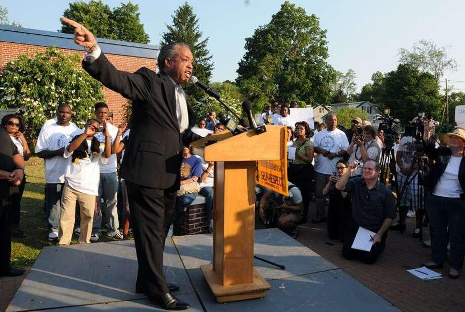 The Rev. Al Sharpton speaks during a rally at Brookside Elementary School in Norwalk Tuesday. Mara Lavitt/Register