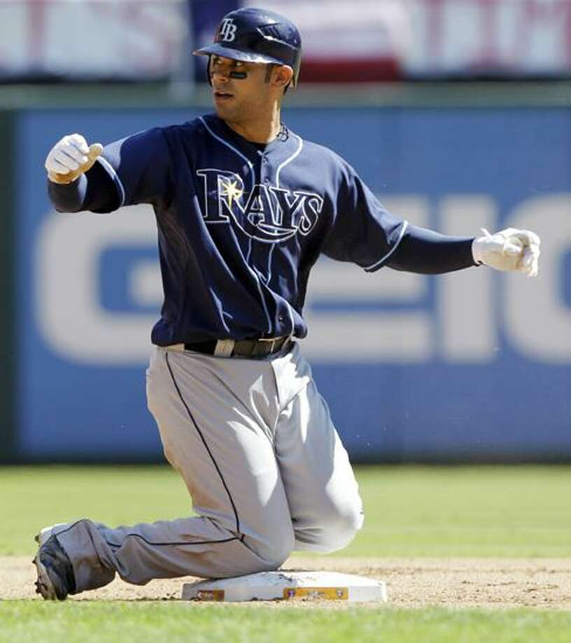 Tampa Bay Rays' Carlos Pena slides safely into second after driving in Evan Longoria for a run in the fourth inning of Game 4 of baseball's American League Division Series against the Texas Rangers Sunday in Arlington, Texas. (AP Photo/David J. Phillip) Photo: AP / AP