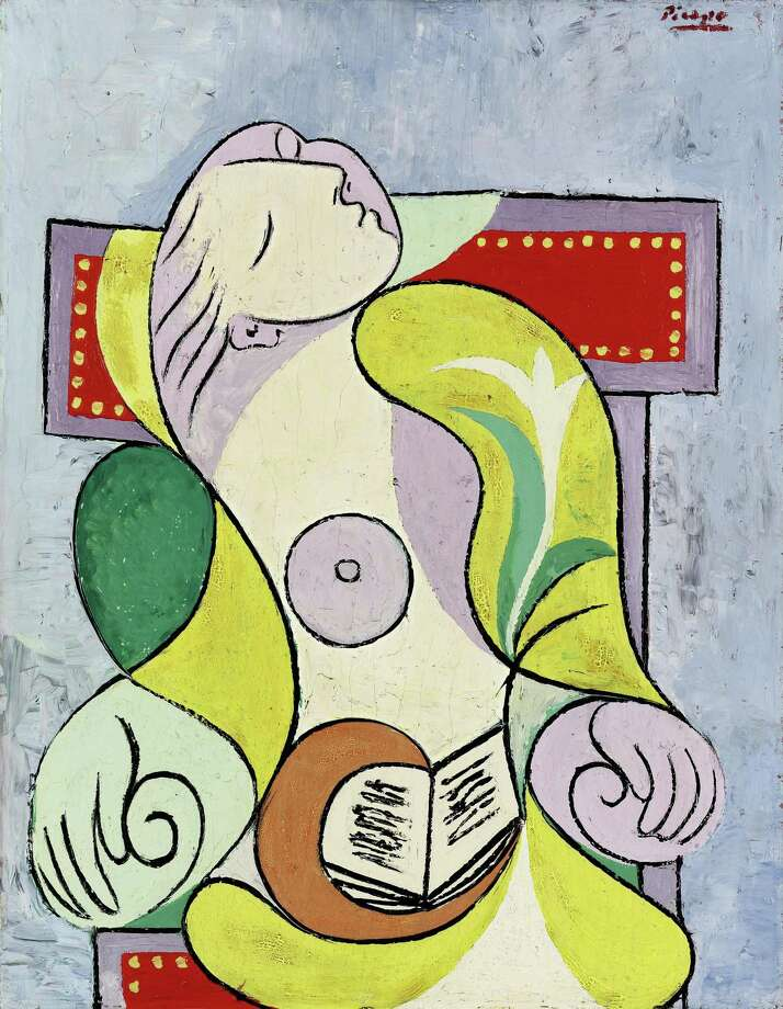 """This photo released by Sotheby's, Tuesday, shows the painting La Lecture,  by Pablo Picasso. The painting, depicting his young lover Marie-Therese Walter, has sold for 25.2 million pounds ($40.7 million) at a London auction Tuesday. Sotheby's says the 1932 painting, called """"La Lecture,"""" was bought by an anonymous buyer over the phone after some six minutes of heated contest among bidders.  (AP Photo / Sotheby's / ho) Photo: ASSOCIATED PRESS / AP2011"""