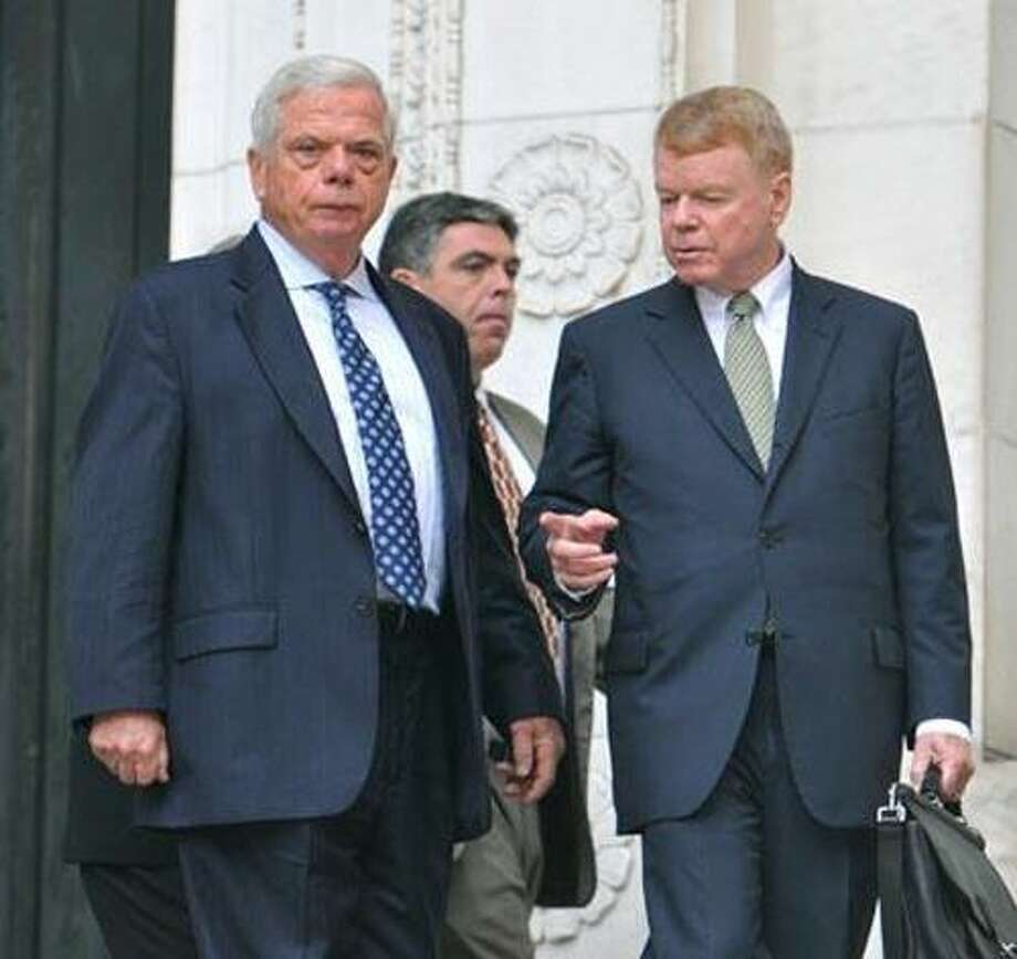 FILE PHOTO: James Byrne of Madison, left, emerges from Superior Court in New Haven with his attorney, Hugh F. Keefe of New Haven. (Peter Casolino/Register)