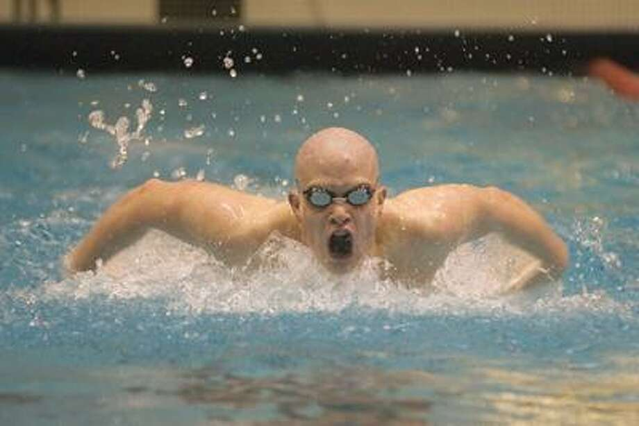 Middletown's Ethan Cooke competes in the 100 yard Butterfly Thursday during the CIAC Championship Meet at Weslyan University. (Max Steinmetz / Special to the Press)