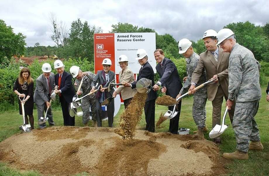 Maj. Gen. William Monk III, commanding general of the Army Reserve's 99th Regional Support Command speaks at the groundbreaking ceremony for the Midldetown Armed Forces Reserve Center at 375 Smith St. At right, Governor M. Jodi Rell and Mayor Sebastian Giuliano are shown. (Catherine Avalone