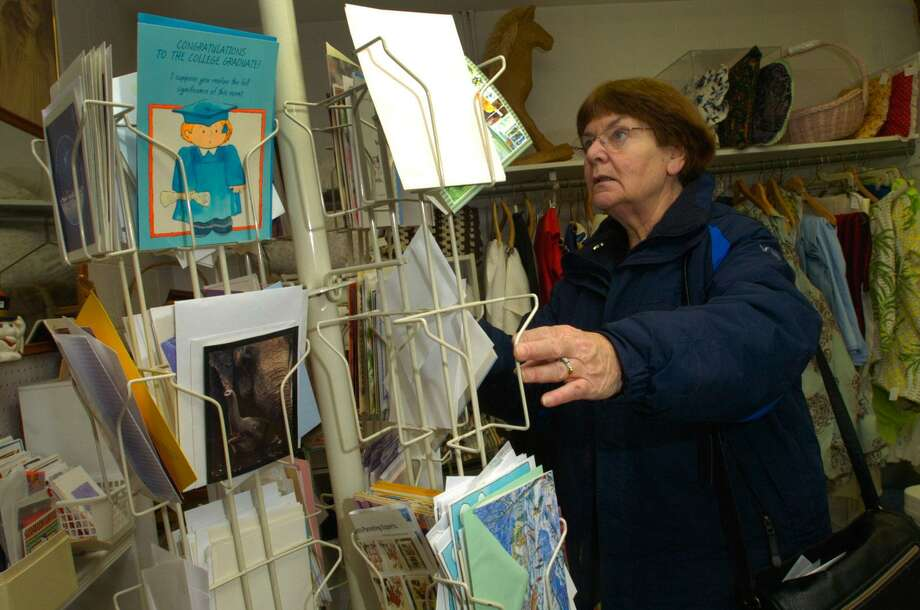 Joan Vitali, of Norwalk, Conn., looks for cards at Norwalk's Treasure House thrift store on Jan. 29, 2011. The Treasure House, which was designed as a fundraising arm of the Norwalk Hospital, celebrated its 50th anniversary last week. (AP Photo/The Hour, Erik Trautmann) Photo: AP / The Hour