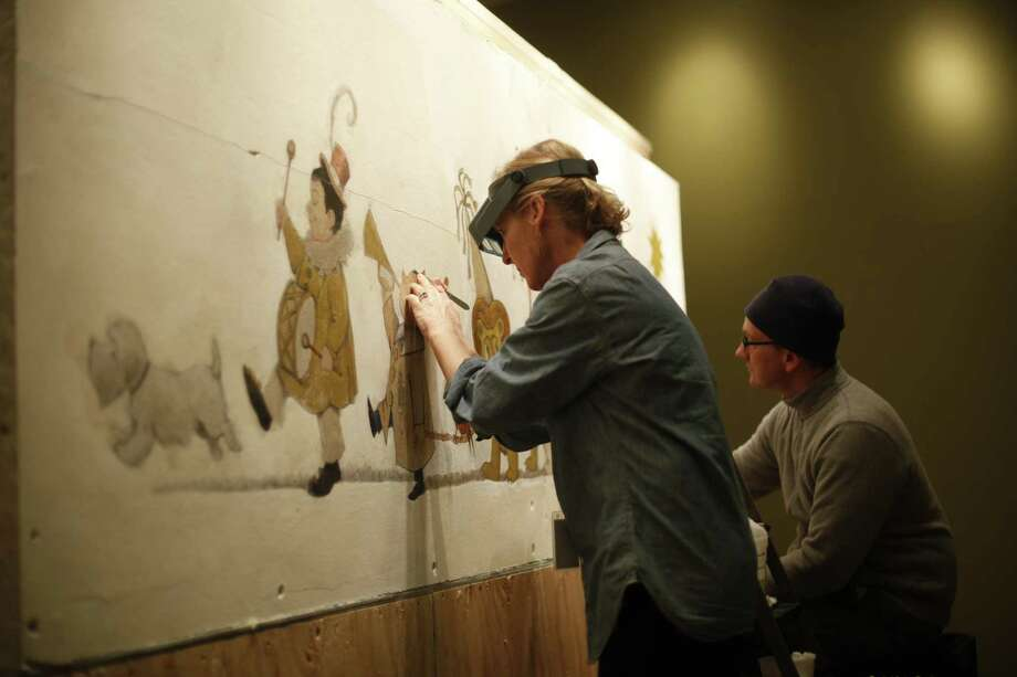 In this photo, mural paintings conservator Cassie Myers and conservation technician Lee Dunsmore with Milner + Carr Conservation LLC perform a conservation treatment on Maurice Sendak's 1961 The Chertoff Mural at the  Rosenbach Museum & Library in Philadelphia. (AP Photo/Matt Rourke) Photo: ASSOCIATED PRESS / AP2011