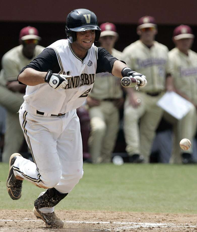 Vanderbilt's Jason Esposito beats out a bunt to reach second on a throwing error by Florida State in the sixth inning during an NCAA super regional baseball game on Sunday, June 13, 2010, in Tallahassee, Fla. (AP Photo/Steve Cannon) Photo: ASSOCIATED PRESS / AP2010
