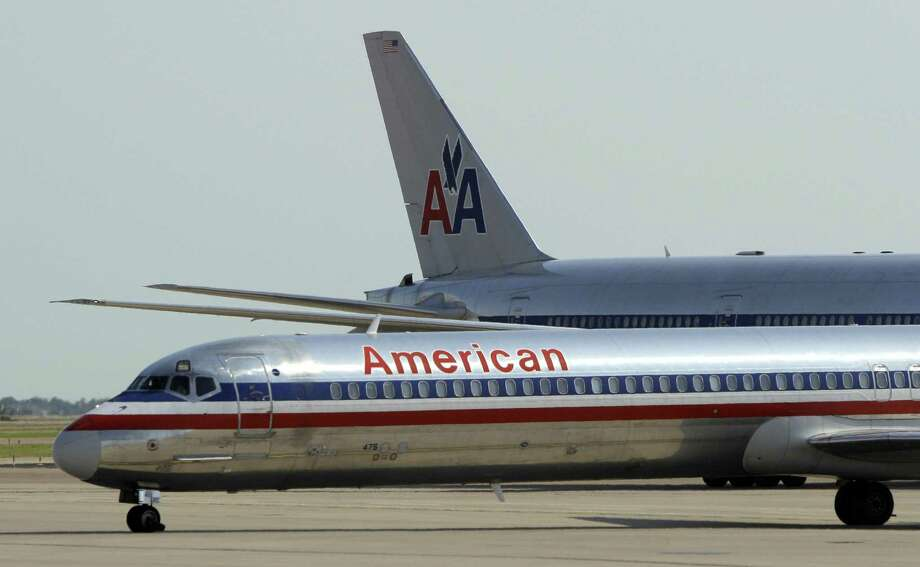 In this June 29, 2011 photo, an American Airlines aircraft is shown at Dallas-Fort Worth International Airport, in Grapevine, Texas. The parent companies of American Airlines and its regional affiliate American Eagle are filing for Ch. 11 bankruptcy protection Tuesday. (AP Photo/Tony Gutierrez) Photo: ASSOCIATED PRESS / AP2011