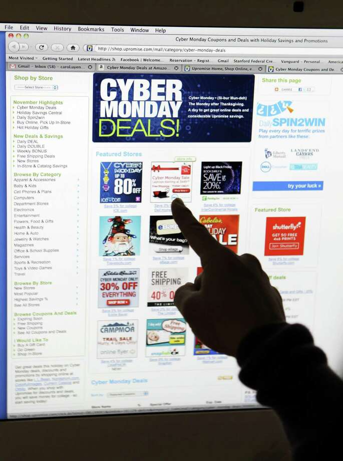 In this file photo from 2010, Consumer Carol Uyeno points out Cyber Monday sales on her computer at her home in Palo Alto, Calif.  Retailers are coming up with names for just about every day of the week during the holiday shopping season.  Associated Press Photo: ASSOCIATED PRESS / AP2010