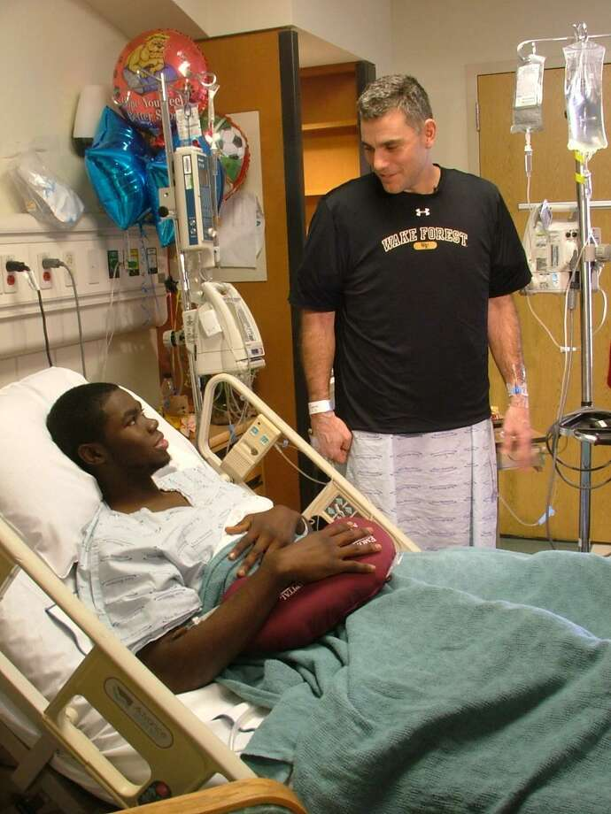 AP In this provided by Wake Forest University, Wake Forest baseball coach Tom Walter, right, visits with player Kevin Jordan one day after donating a kidney to Jordan at Emory University Hospital in Atlanta on Tuesday. Jordan was diagnosed last April with ANCA vasculitis, a type of autoimmune swelling disorder caused by abnormal antibodies.