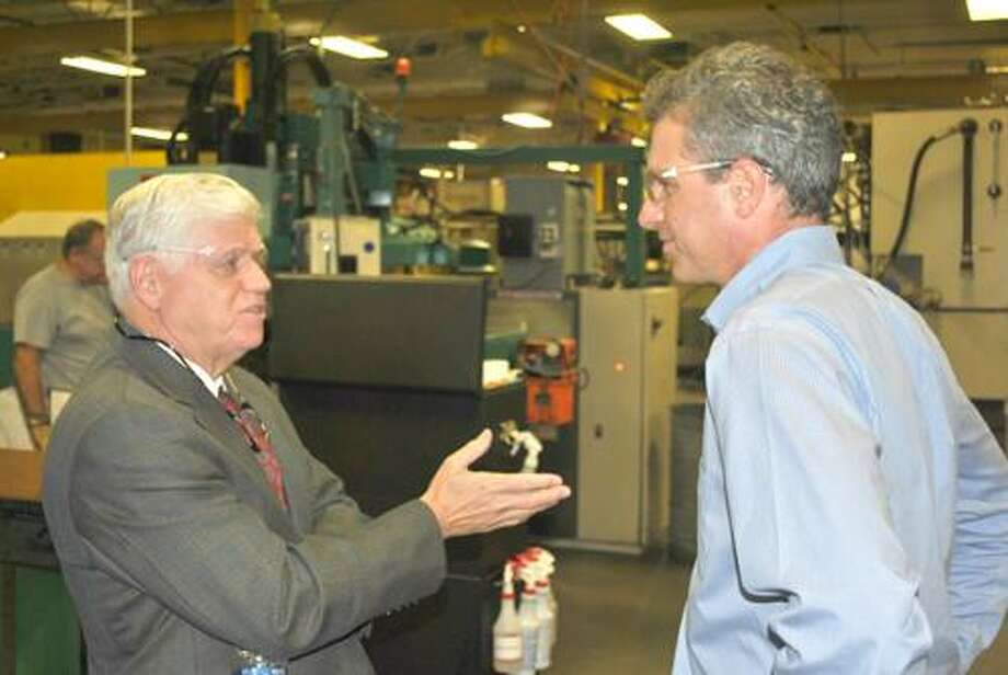Congressman John Larson gets a tour of Jarvis Airfoil by company manager Jason Jarvis on Thursday.