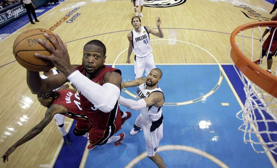 Miami Heat's Dwyane Wade goes up for a shot during the second half of Game 3 of the NBA Finals basketball game against the Dallas Mavericks Sunday, June 5, 2011, in Dallas. The Heat won 88-86 take a 2-1 lead in the series. (AP Photo/David J. Phillip; Pool) Photo: ASSOCIATED PRESS / AP2011