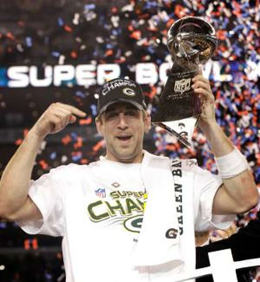 AP Green Bay Packers quarterback Aaron Rodgers holds the Vince Lombardi Trophy while celebrating the Packers' 31-25 win against the Pittsburgh Steelers in Super Bowl XLV on Sunday in Arlington, Texas.