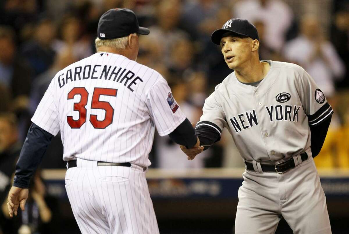 Minnesota Twins manager Ron Gardenhire and New York Yankees manager Joe Girardi shake hands before Game 1 of baseball's American League Division Series on Wednesday. (AP Photo/Charlie Neibergall)
