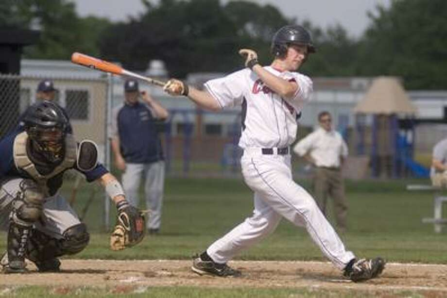 Cromwell's John McMahon swings at a pitch in a Shoreline Conference playoff game at Cromwell High School. (Max Steinmetz / Special to the Press)