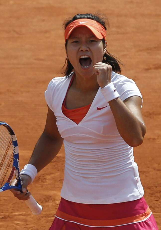 ASSOCIATED PRESS  China's Li Na reacts as she plays Italy's Francesca Schiavone during their women's final match for the French Open tennis tournament at the Roland Garros stadium, Saturday in Paris.