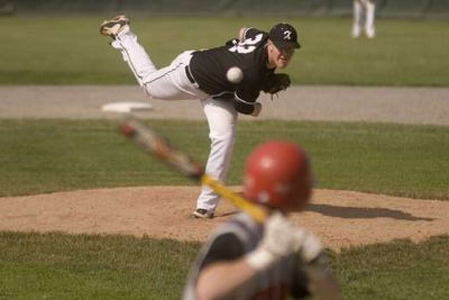 Xavier's Shaun Coughlin throws a pitch in the Class LL state tournament at Palmer field in Middletown June 2nd. (Max Steinmetz / Special to the Press)
