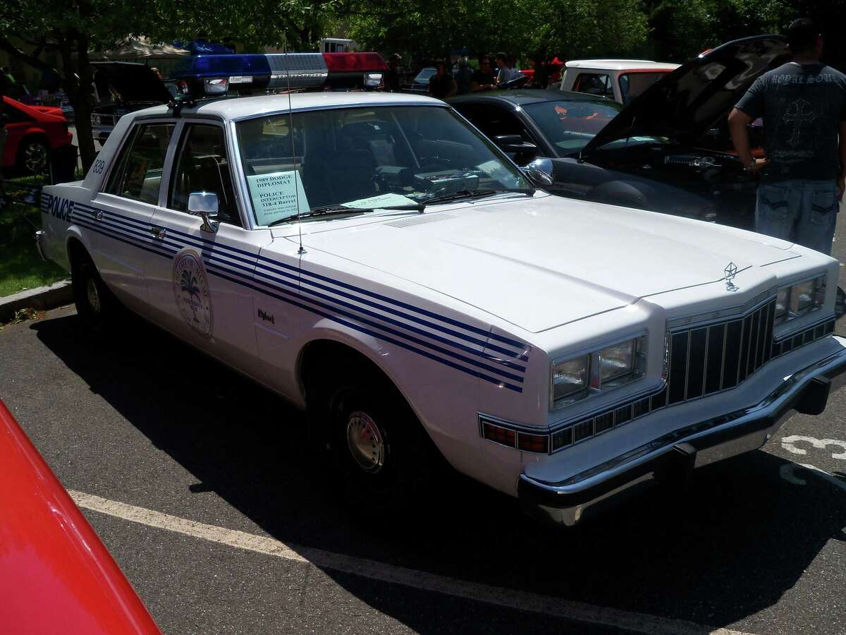 1989 Dodge Diplomat. Retired from service in 2002 from the Miami Police Department. Currently owned by T. Wright in North Granby.