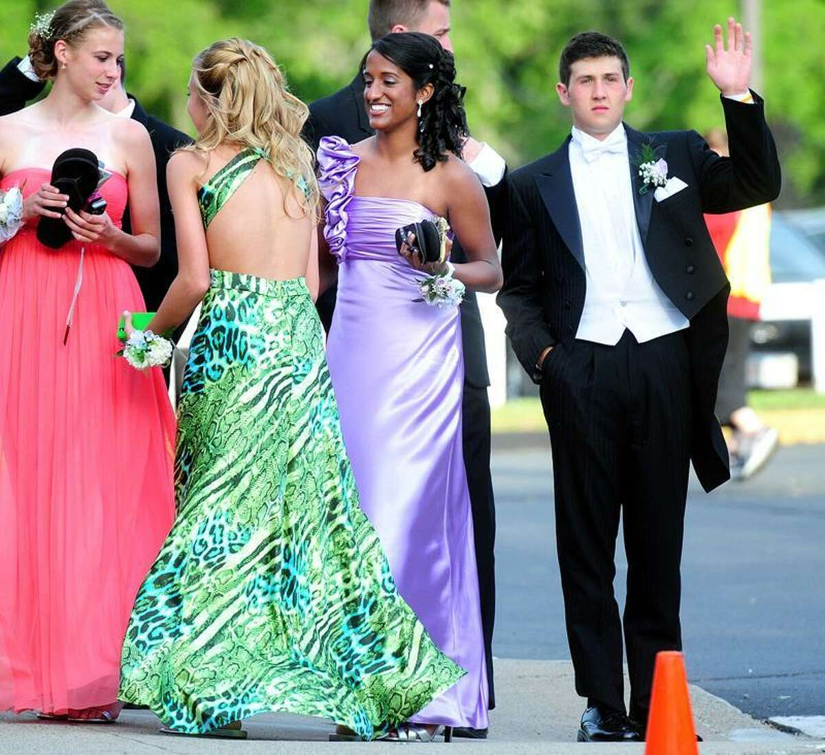 Sonali Rodrigues, center, and her date, James Tate ,right, arrive at the Shelton High School prom held at the Toyota Presents the Oakdale Theatre in Wallingford Saturday. Photo by Arnold Gold/New Haven Register