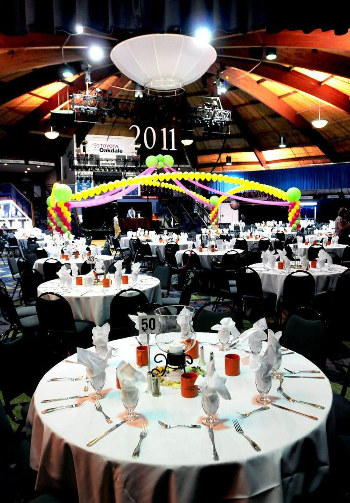 Table 50, foreground, at the Toyota Presents the Oakdale Theatre in Wallingford is where James Tate and his date, Sonali Rodrigues, were seated during the Shelton High School prom Saturday. Photo by Arnold Gold/New Haven Register
