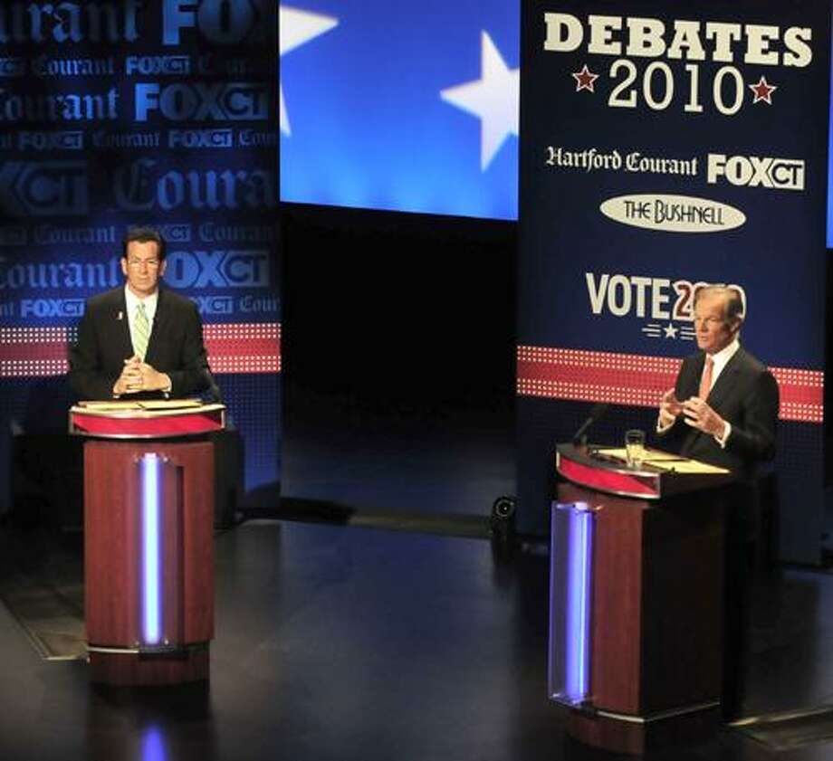 Democratic candidate for governor Dan Malloy, left, and Republican candidate Tom Foley debate in Hartford, Conn., on Tuesday, Oct. 5, 2010. (AP Photo/John Woike, Pool) Photo: AP / AP2010