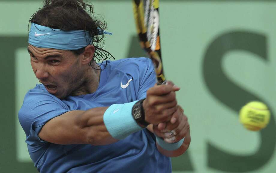 ASSOCIATED PRESS - Rafael Nadal of Spain returns against Roger Federer of Switzerland in the men's final of the French Open tennis tournament in Roland Garros stadium in Paris on Sunday. Photo: ASSOCIATED PRESS / AP2011
