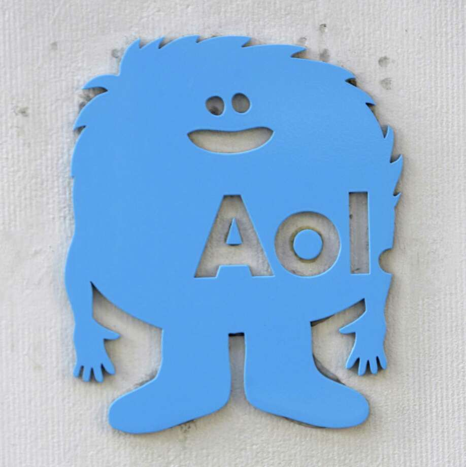 A small AOL placard is displayed on their offices in New York, Monday. Internet company AOL Inc. is buying news hub Huffington Post in a $315 million deal that represents a bold bet on the future of online news. (AP Photo/Seth Wenig) Photo: ASSOCIATED PRESS / AP2011